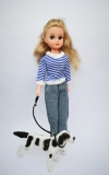 a Fleur doll in Jeans outfit with dog