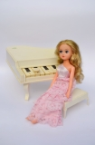 a Fleur doll piano and Concert Fleur