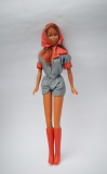 Super Linna doll in original clothing, unplayed condition
