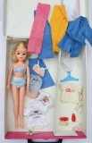 Sindy case with dolls and clothes
